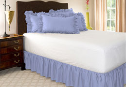 solid ruffled poly cotton bedskirt on bed