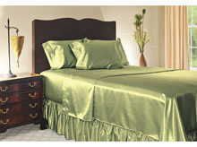 set of satin linen on a bed