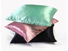 satin pillowcases in different colors piled up